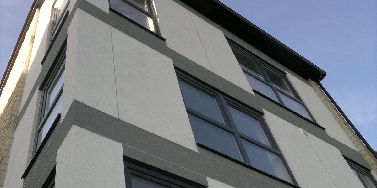 Four storey homes with a contemporary façade of flush cladding panels and full height glazing